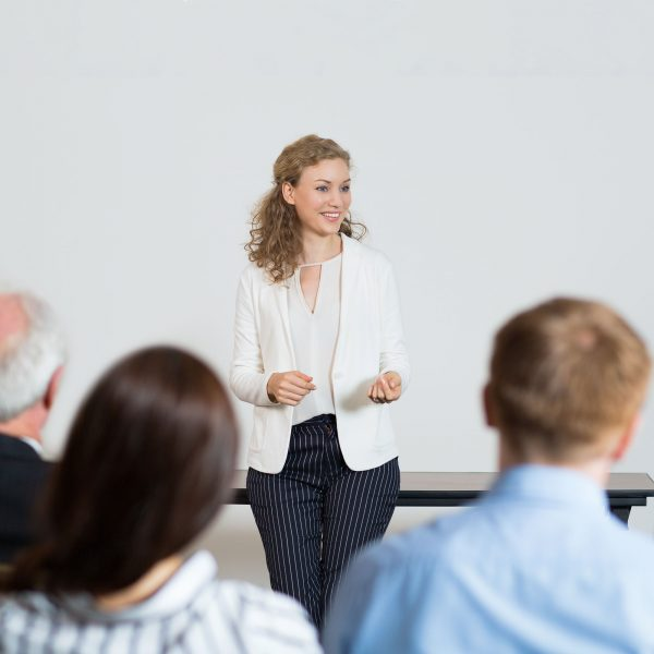 Successful Young Businesswoman Holding Speech